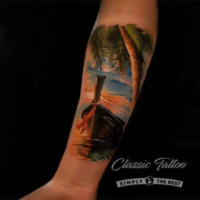 Пейзаж у моря - тату на предплечье девушки в стиле реализм