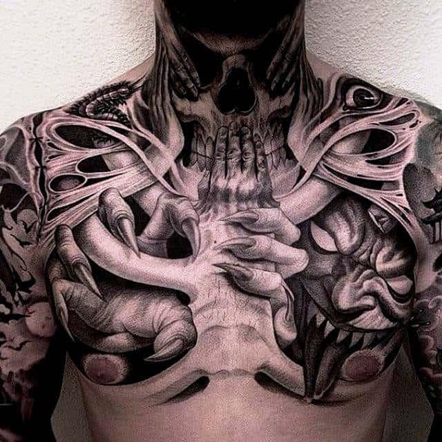 Монохромное хоррор тату на груди мужчины - скелет, череп, демон